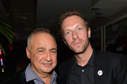 Owner of Warner Music Group Len Blavatnik and musician Chris Martin of Coldplay attend the Warner Music Group annual GRAMMY celebration on January 26, 2014 in Los Angeles, California.