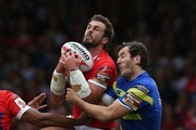 Stefan Ratchford of Warrington Wolves jumps for a high ball with Josh Mantellato (L) of Hull KR during the Ladbrokes Challenge Cup Semi-Final match between Warrington Wolves and Hull KR at the Headingley Carnegie Stadium on August 1, 2015 in Leeds, England.