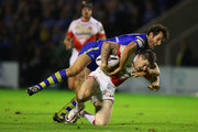 Mark Percival of St Helens is tackled by Stefan Ratchford of Warrington Wolves during the First Utility Super League Semi Final match between Warrington Wolves and St Helens at The Halliwell Jones Stadium on September 29, 2016 in Warrington, England.