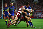 Stefan Ratchford of Warrington Wolves is tackled during the BetFred Super League Grand Final between Warrington Wolves and Wigan Warriors at Old Trafford on October 13, 2018 in Manchester, England.