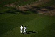 Olly Stone and Chris Wright of Warwickshire make their way out to bt after tea during Day Two of the Specsavers County Championship Division Two match between Warwickshire and Kent at Edgbaston on September 25, 2018 in Birmingham, England.
