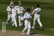 Surrey bowler Jade Dernbach (r) celebrates with team mates after dismissing Warwickshire batsman William Porterfield during day three of the Specsavers County Championship: Division One between Warwickshire and Surrey at Edgbaston on April 23, 2017 in Birmingham, England.