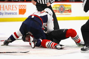Devante Smith-Pelly #25 of the Washington Capitals jumps on Connor Murphy #5 of the Chicago Blackhawks at the United Center on February 17, 2018 in Chicago, Illinois. The Blackhawks defeated the Capitals 7-1.