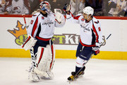 Alex Ovechkin #8 of the Washington Capitals celebrates his game winning goal against the Colorado Avalanche with goalie Braden Holtby #70 of the Washington Capitals in the third period at Pepsi Center on November 20, 2014 in Denver, Colorado. The Capitals defeated the Avalanche 3-2.