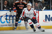 Joey Crabb #15 of the Washington Capitals skates against the New York Islanders at the Nassau Veterans Memorial Coliseum on March 9, 2013 in Uniondale, New York. The Islanders defeated the Capitals 5-2.
