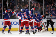 (L-R) Marian Gaborik #10, Brad Richards #19, Michael Del Zotto #4 and Ryan Callahan #24 of the New York Rangers celebrate after Callahan scored a goal in the third period against the Washington Capitals in Game Two of the Eastern Conference Semifinals during the 2012 NHL Stanley Cup Playoffs at Madison Square Garden on April 30, 2012 in New York City.