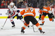 Nicklas Backstrom #19 of the Washington Capitals skates with the puck past Sean Couturier #14 of the Philadelphia Flyersduring the first period at Wells Fargo Center on March 18, 2018 in Philadelphia, Pennsylvania.