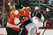Kimmo Timonen #44 of the Philadelphia Flyers and Joey Crabb #15 of the Washington Capitals collide on February 27, 2013 at the Wells Fargo Center in Philadelphia, Pennsylvania. The Philadelphia Flyers defeated the Washington Capitals 4-1.