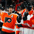 Kimmo Timonen #44 of the Philadelphia Flyers is congratulated by teammates after he scored a goal to tie the game late in the third period of an NHL hockey game against the Washington Capitals at Wells Fargo Center on March 31, 2013 in Philadelphia, Pennsylvania.  Flyers won 5-4 in overtime.