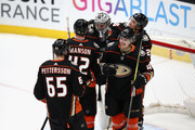 Hampus Lindholm #47, Josh Manson #42 and Marcus Pettersson #65 congratulate John Gibson #36 of the Anaheim Ducks after defeating the Washington Capitals 4-0 in a game at Honda Center on March 6, 2018 in Anaheim, California.