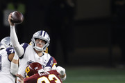 Andy Dalton #14 of the Dallas Cowboys attempts to get a pass off against Jonathan Allen #93 of the Washington Football Team during the fourth quarter of a game at AT&T Stadium on November 26, 2020 in Arlington, Texas.