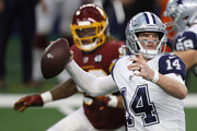 Andy Dalton #14 of the Dallas Cowboys looks to pass during the second quarter of a game against the Washington Football Team at AT&T Stadium on November 26, 2020 in Arlington, Texas.