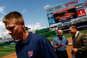 Stephen Strasburg (L), the overall first pick in the 2009 Major League Baseball draft, arrives for a press conference where he was introduced at Nationals Park August 21, 2009 in Washington, DC. Strasburg, a right handed pitcher from San Diego State University, signed with the Nationals earlier this week wth a record contract for an amateur player. Also pictured are Stan Kasten (C) Nationals Team President, and Strasburg's agent Scott Boras (R).