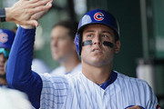 Anthony Rizzo #44 of the Chicago Cubs is congratulated in the dugout after scoring in the 6th inning against the Washington Nationals at Wrigley Field on August 10, 2018 in Chicago, Illinois.