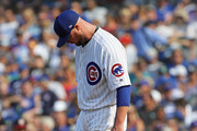 Starting pitcher Jon Lester #34 of the Chicago Cubs reacts after giving up a three run home run in the 4th inning to Ryan Zimmerman of the Washington Nationals at Wrigley Field on August 11, 2018 in Chicago, Illinois.