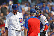 Starting pitcher Jon Lester #34 of the Chicago Cubs is taken out of the game by manager Joe Maddon #70 after giving up a three run home run in the 4th inning to Ryan Zimmerman of the Washington Nationals at Wrigley Field on August 11, 2018 in Chicago, Illinois.