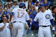 Kris Bryant #17 of the Chicago Cubs is greeted by Anthony Rizzo #44 after hitting a home run against the Washington Nationals during the first inning on May 25, 2015 at Wrigley Field in Chicago, Illinois.