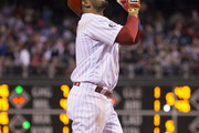 Andres Blanco #4 of the Philadelphia Phillies reacts after hitting a solo home run in the bottom of the seventh inning against the Washington Nationals at Citizens Bank Park on April 8, 2017 in Philadelphia, Pennsylvania. The Phillies defeated the Nationals 17-3.
