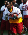 Running back Clinton Portis #26 of the Washington Redskins carries the ball during drills on the first day of training camp July 29, 2010 in Ashburn, Virginia.