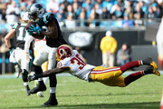 Jerricho Cotchery #82 of the Carolina Panthers makes a catch against  Kyshoen Jarrett #30 of the Washington Redskins in the 2nd quarter during their game at Bank of America Stadium on November 22, 2015 in Charlotte, North Carolina.