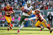 Eric Decker #87 of the New York Jets attempts to avoid the tackle attempt of Kyshoen Jarrett #30 of the Washington Redskins during the third quarter at MetLife Stadium on October 18, 2015 in East Rutherford, New Jersey.