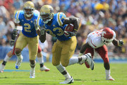 Running back Derrick Coleman #33 of the UCLA Bruins carries the ball during the second quarter against the Washington State Cougars at the Rose Bowl on October 2, 2010 in Pasadena, California. UCLA defeated Washington State 42-28.