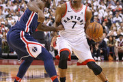 Ty Lawson #4 of the Washington Wizards fouls Kyle Lowry #7 of the Toronto Raptors in Game Two of the Eastern Conference First Round in the 2018 NBA Play-offs at the Air Canada Centre on April 17, 2018 in Toronto, Ontario, Canada. The Raptors defeated the Wizards 130-119.