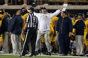 Head coach Jeff Tedford of the California Golden Bears argues a call with head linesman James Wharrie during their game against the Washington Huskies at California Memorial Stadium on November 2, 2012 in Berkeley, California.