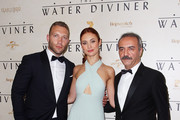 "Jai Courtney, Olga Kurylenko and Yilmaz Erdogan arrive at the World Premier of ""The Water Diviner"" at the State Theatre on December 2, 2014 in Sydney, Australia."
