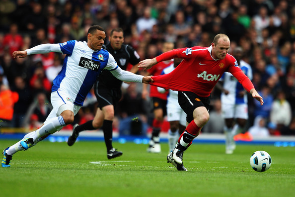 Wayne Rooney Jermaine Jones of Blackburn holds the shirt of Wayne Rooney of Manchester United during the Barclays Premier League match between Blackburn Rovers and Manchester United at Ewood park on May 14, 2011 in Blackburn, England.