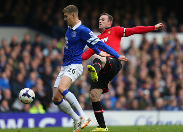 Wayne Rooney Vs Everton Wayne Rooney John Stones of Everton and Wayne Rooney of Manchester