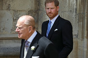 Prince Philip, Duke of Edinburgh and Prince Harry, Duke of Sussex leave after the wedding of Lady Gabriella Windsor to Thomas Kingston at St George's Chapel, Windsor Castle on May 18, 2019 in Windsor, England.