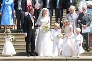 Newlyweds Mr Thomas Kingston and Lady Gabriella Windsor smile on the steps of the chapel with Princess Michael of Kent, Prince Michael of Kent and their bridesmaids and page boys after their wedding at St George's Chapel on May 18, 2019 in Windsor, England.