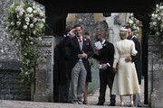 Spencer Matthews, left, gestures as he stands with James Middleton, right, and Donna Air at the entrance of St Mark's Church ahead of the wedding of Pippa Middleton and James Matthews on May 20, 2017 in Englefield, England. Middleton, the sister of Catherine, Duchess of Cambridge is to marry hedge fund manager James Matthews in a ceremony Saturday where her niece and nephew Prince George and Princess Charlotte are in the wedding party, along with sister Kate and princes Harry and William.
