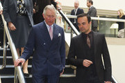 Prince Charles, Prince of Wales meets Evening Standard owner Evgeny Lebedev during a visit to the London Evening Standard offices in Kensington on February 25, 2015 in London, United Kingdom.