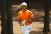 Rickie Fowler walks the second fairway during the final round of the 2018 Wells Fargo Championship at Quail Hollow Club on May 6, 2018 in Charlotte, North Carolina.