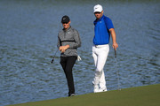 Rory McIlroy(L) of Northern Ireland and Paul Casey of England look on from the 14th hole during the first round of the 2018 Wells Fargo Championship at Quail Hollow Club on May 3, 2018 in Charlotte, North Carolina.