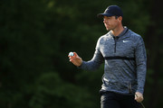 Rory McIlroy of Northern Ireland acknowledges the gallery after making his birdie putt on the 12th green during the first round of the 2018 Wells Fargo Championship at Quail Hollow Club on May 3, 2018 in Charlotte, North Carolina.