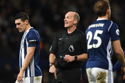Referee Mike Dean during the Premier League match between West Bromwich Albion and Arsenal at The Hawthorns on December 31, 2017 in West Bromwich, England.