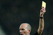 Referee Mike Dean in action during the Premier League match between West Bromwich Albion and Arsenal at The Hawthorns on December 31, 2017 in West Bromwich, England.