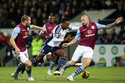 Saido Berahino of West Brom controls the ball from Ron Vlaar and Alan Hutton of Aston Villa during the Barclays Premier League match between West Bromwich Albion and Aston Villa at The Hawthorns on December 13, 2014 in West Bromwich, England.