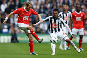 Gonzalo Jara of West Brom is challenged by Lee Bowyer of Birmingham during the Barclays Premier League match between West Bromwich Albion and Birmingham City at The Hawthorns on September 18, 2010 in West Bromwich, England.