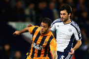 Hatem Ben Arfa of Hull City holds off Claudio Yacob of West Bromwich Albion during the Capital One Cup Third Round match between West Bromwich Albion and Hull City at The Hawthorns on September 24, 2014 in West Bromwich, England.