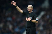 Referee Mike Dean gestures during the Barclays Premier League match between West Bromwich Albion and Manchester United at The Hawthorns on March 6, 2016 in West Bromwich, England.