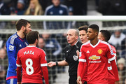 Referee Mike Dean talks with Juan Mata of Manchester United as he is sent off during the Barclays Premier League match between West Bromwich Albion and Manchester United at The Hawthorns on March 6, 2016 in West Bromwich, England.