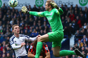 Robert Green of QPR collides with Yoon Suk-Young of QPR during the Barclays Premier league match West Bromwich Albion and Queens Park Rangers at The Hawthorns on April 4, 2015 in West Bromwich, England.