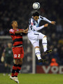 Gonzalo Jara of West Bromwich Albion battles with Jay Simpson of QPR during the Coca-Cola Championship match between West Bromwich Albion and Queens Park Rangers at The Hawthorns on December 14, 2009 in West Bromwich, England.