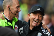 Tony Pulis manager of West Bromwich Albion jokes with official Mike Dean prior to the Barclays Premier League match between West Bromwich Albion and Southampton at The Hawthorns on September 12, 2015 in West Bromwich, United Kingdom.