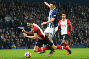Gareth Barry of West Bromwich Albion tackles Wesley Hoedtof Southampton during the Premier League match between West Bromwich Albion and Southampton at The Hawthorns on February 3, 2018 in West Bromwich, England.
