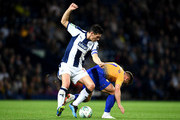 Alex MacDonald of Mansfield Town is challenged by Gareth Barry of West Bromwich Albion during the Carabao Cup Second Round match between West Bromwich Albion and Mansfield Town at The Hawthorns on August 28, 2018 in West Bromwich, England.